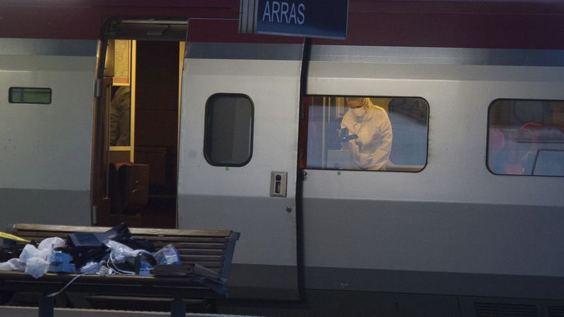 A police officer videos the crime scene inside a Thalys train at Arras train station, northern...