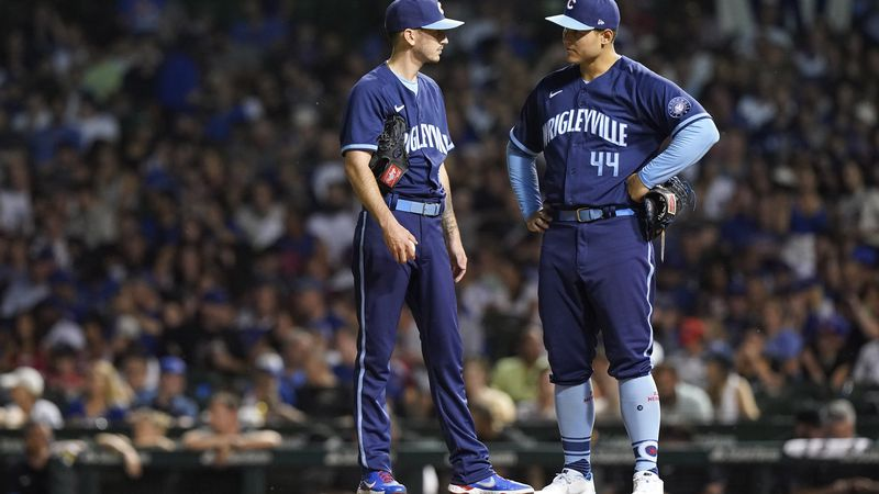 Chicago Cubs starting pitcher Zach Davies, left, listens to first baseman Anthony Rizzo during...
