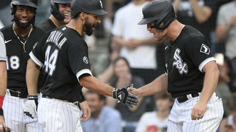 Chicago White Sox's Seby Zavala (44) celebrates at home plate with Adam Engel right, after...