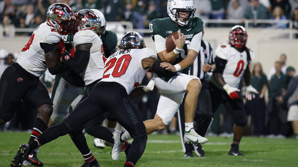 Michigan State quarterback Payton Thorne, right, runs for a touchdown against Western...