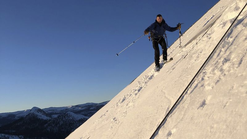 In this photo provided by Jason Torlano, Zach Milligan is shown on his descent down Half Dome...