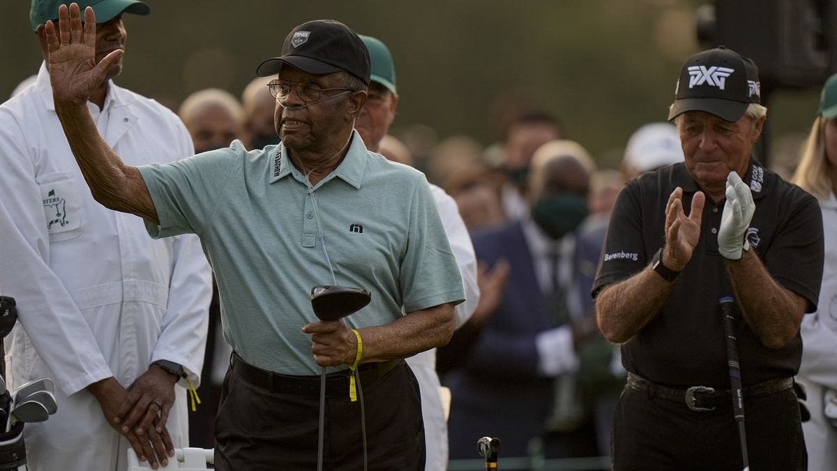 Lee Elder waves with Gary Player before the ceremonial first tee the first round of the Masters...