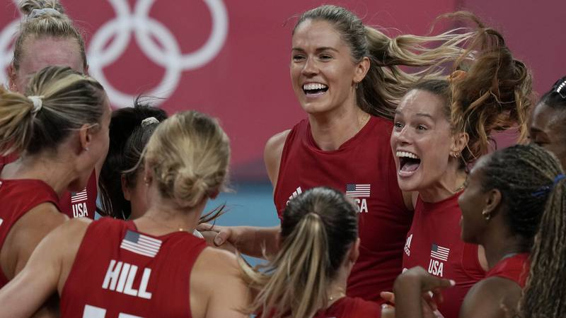United states players celebrate winning the women's volleyball preliminary round pool B match...