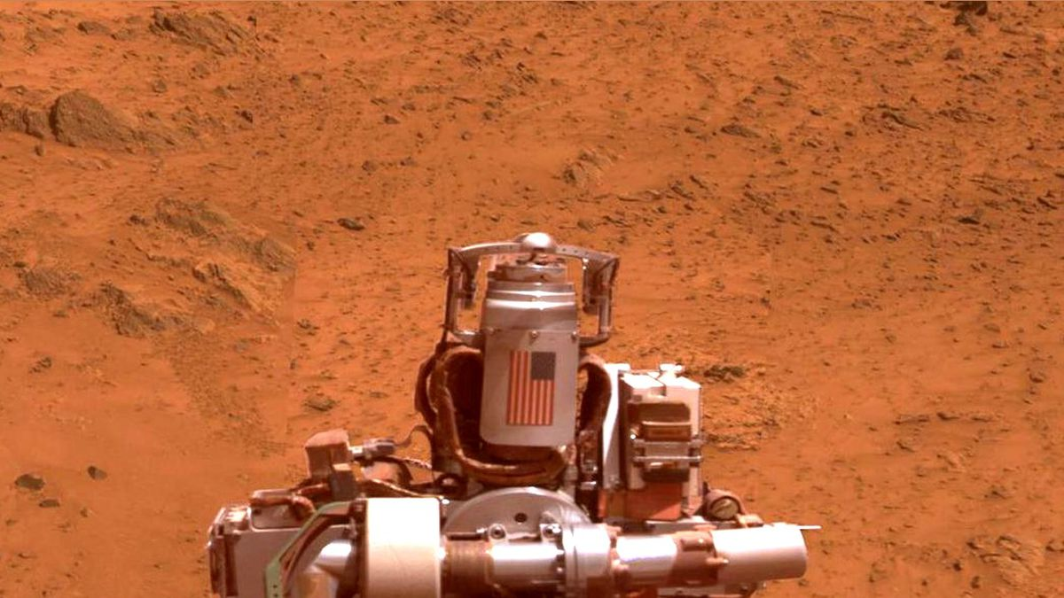 "A view of NASA's Mars Exploration Rover Opportunity gained from the top of the ""Cape..."