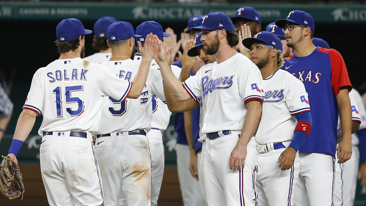 The Texas Rangers celebrate a win over the Chicago White Sox in a baseball game, Saturday,...