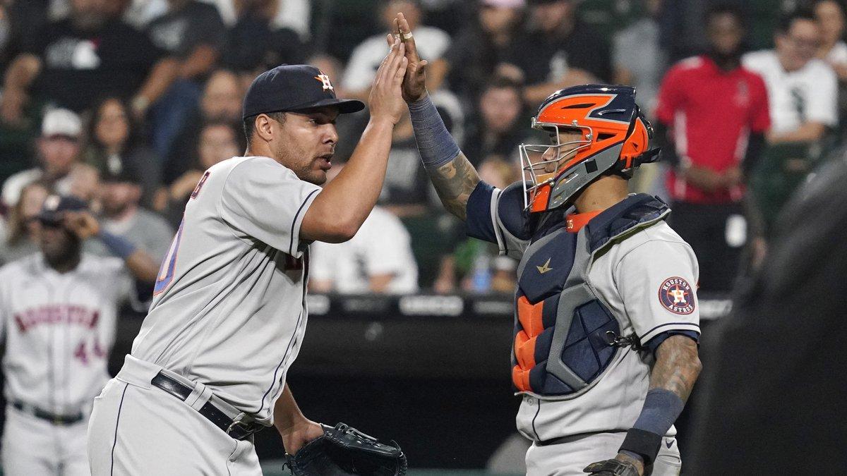 Houston Astros relief pitcher Andre Scrubb, left, celebrates with catcher Martin Maldonado...
