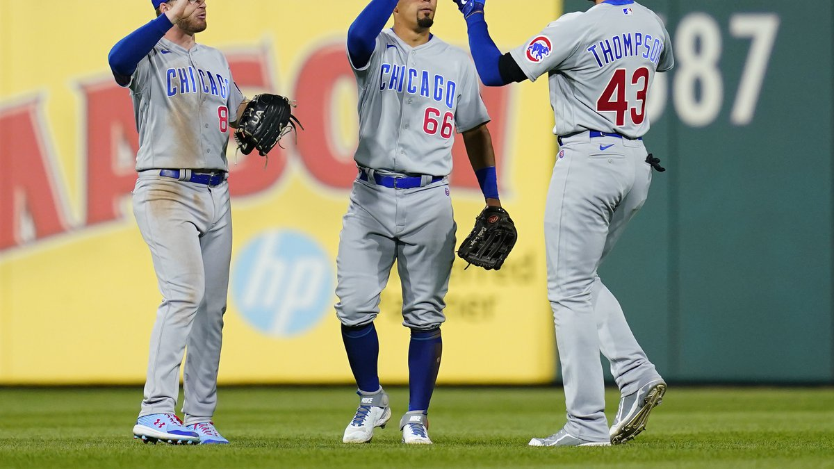 Chicago Cubs' Ian Happ, from left, Rafael Ortega and Trayce Thompson celebrate after a baseball...