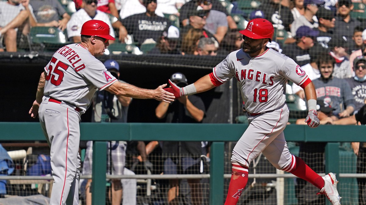 Los Angeles Angels' Jose Rojas, right, celebrates with third base coach Brian Butterfield after...