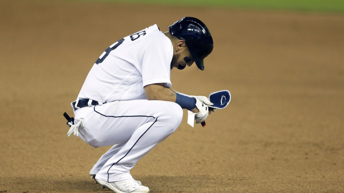 Detroit Tigers' Isaac Paredes reacts after the ball he hit to left field was short of a home...