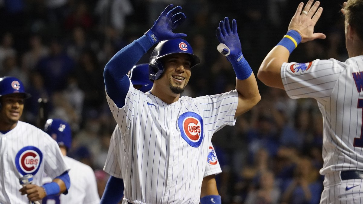 Chicago Cubs' Rafael Ortega, center, celebrates with Patrick Wisdom, right, after hitting a...