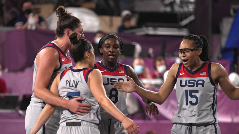 Players from the United States celebrate after beating China in a women's 3-on-3 basketball...