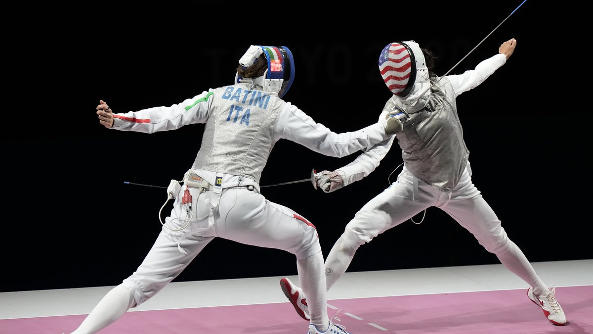CORRECTS ATHLETES - Michela Battiston, of Italy, left, and Lee Kiefer of the United States...