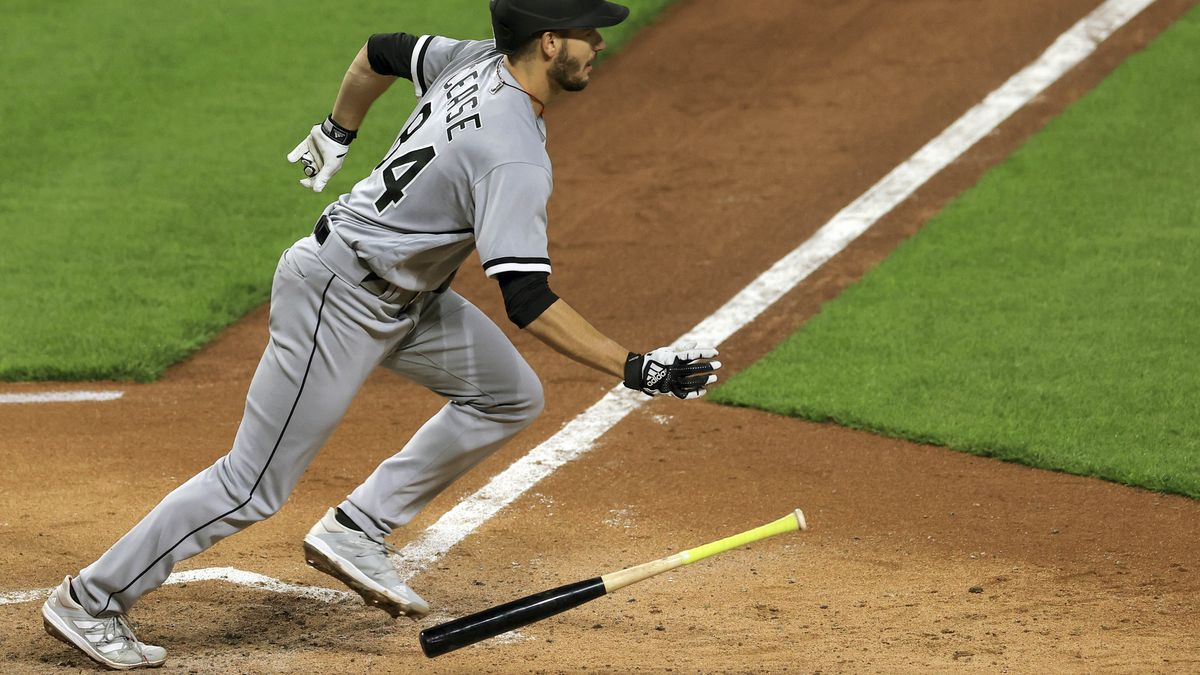 Chicago White Sox Dylan Cease hits for a single during the fifth inning of a baseball game...