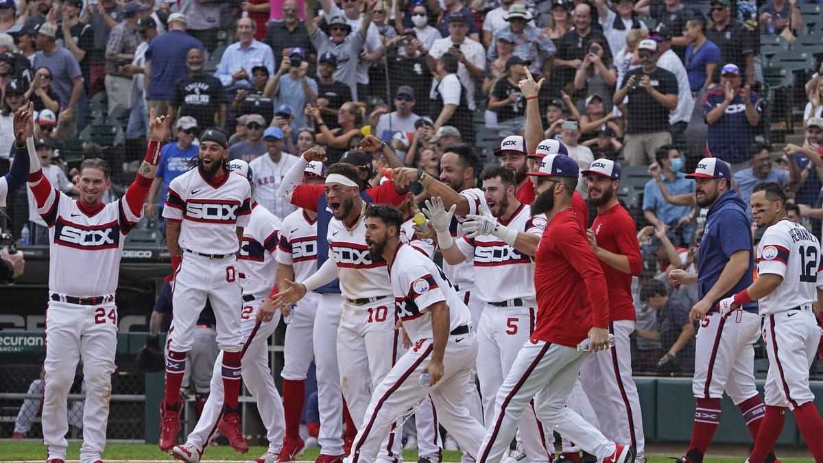 The Chicago White Sox celebrate at home plate teammate Leury Garcia's walkoff home run during...