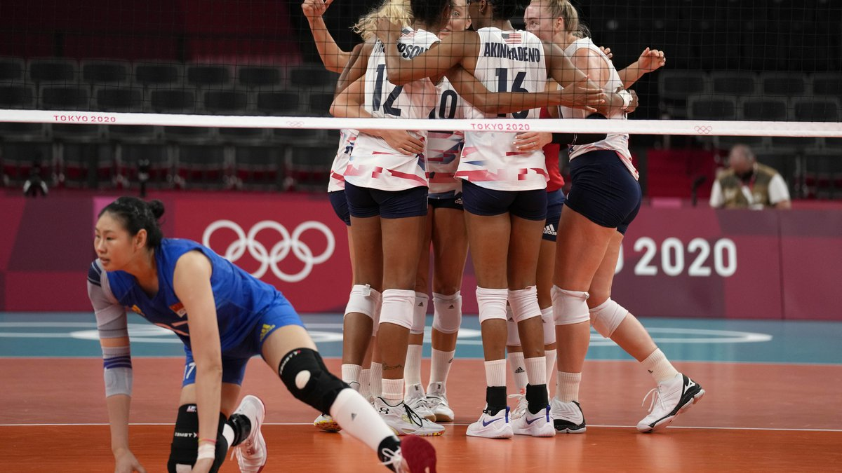 United States teammates celebrate during the women's volleyball preliminary round pool B match...