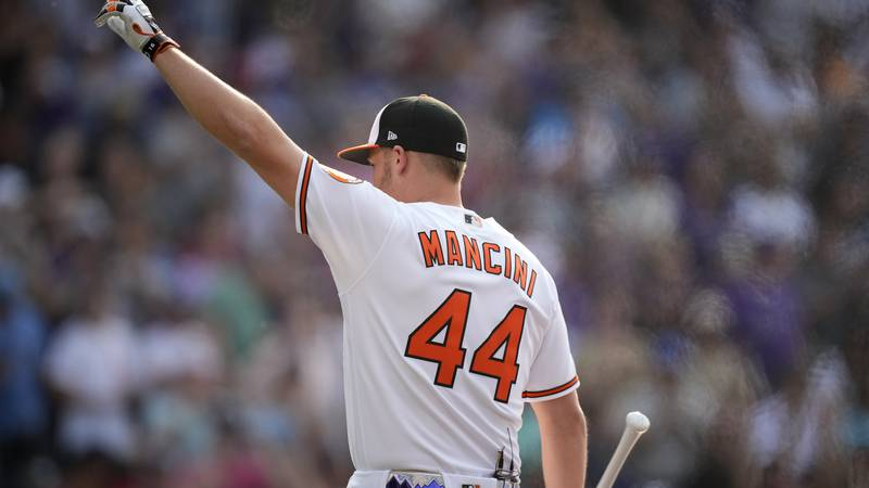 American League's Trey Mancini, of the Baltimore Orioles, waves to fans during the first round...