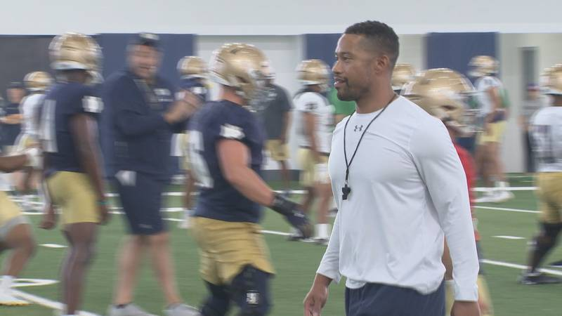 Marcus Freeman greets players during Notre Dame football's first fall camp practice on August...