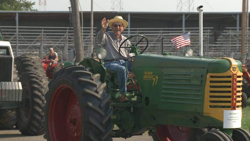 99-year-old Paul Stump still proudly drives his tractor.
