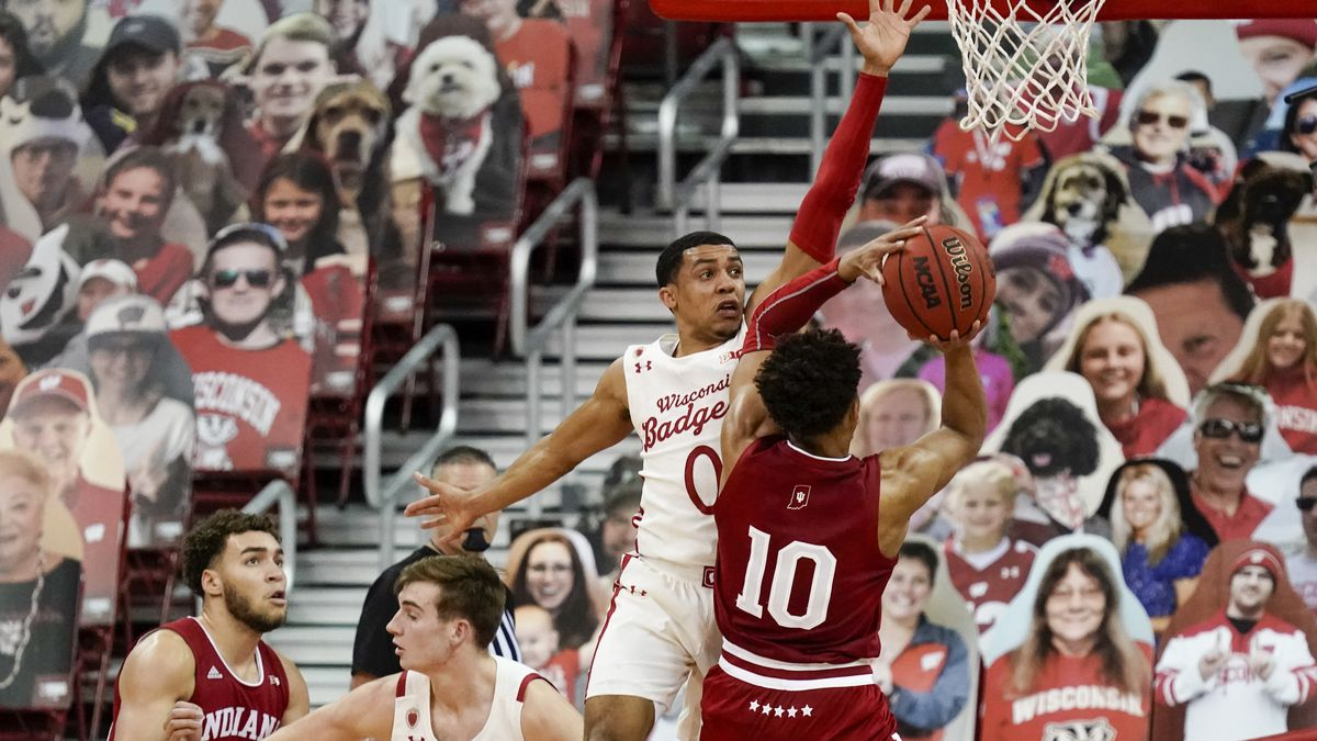 Indiana's Rob Phinisee tries to shoot with Wisconsin's D'Mitrik Trice defending during the...