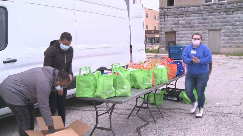 Veggie Van, a mobile farmer's market, sets up shop in Benton Habor to give away bags of fresh...