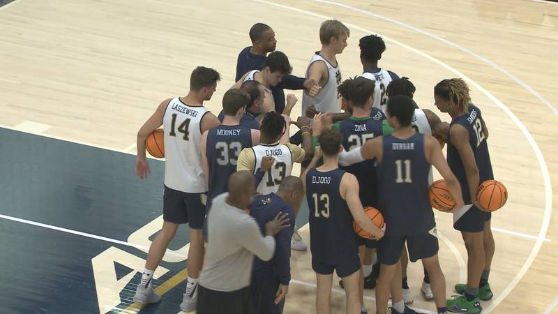 The Notre Dame men's basketball team huddles before a practice on July 21, 2021.