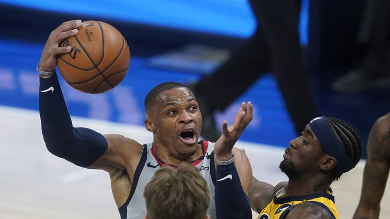 Washington Wizards' Russell Westbrook goes to the basket against Indiana Pacers' Caris LeVert...