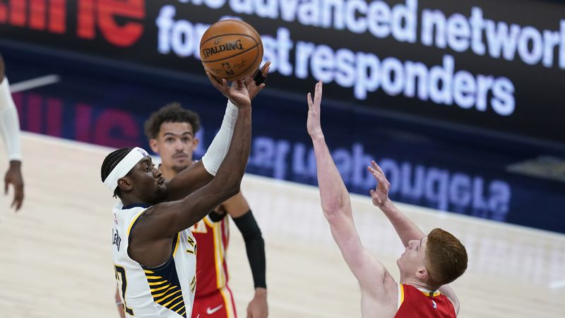 Indiana Pacers' Caris LeVert (22) shoots over Atlanta Hawks' Kevin Huerter (3) during the...