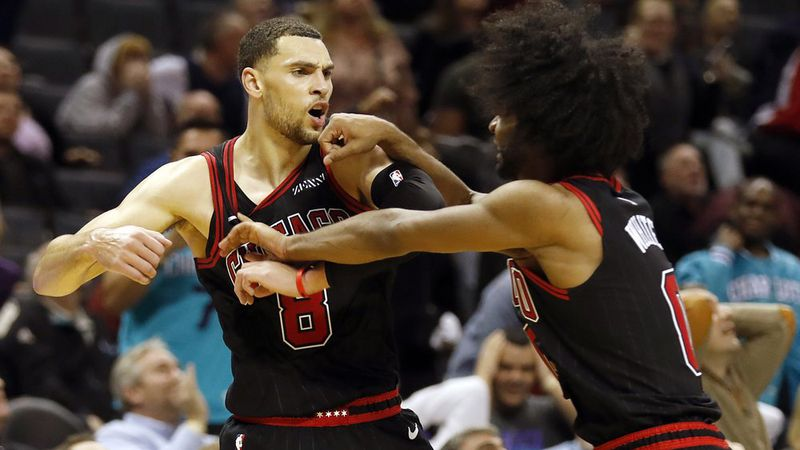 Chicago Bulls' Zach LaVine (8) celebrates his winning three-point basket with teammate Coby...