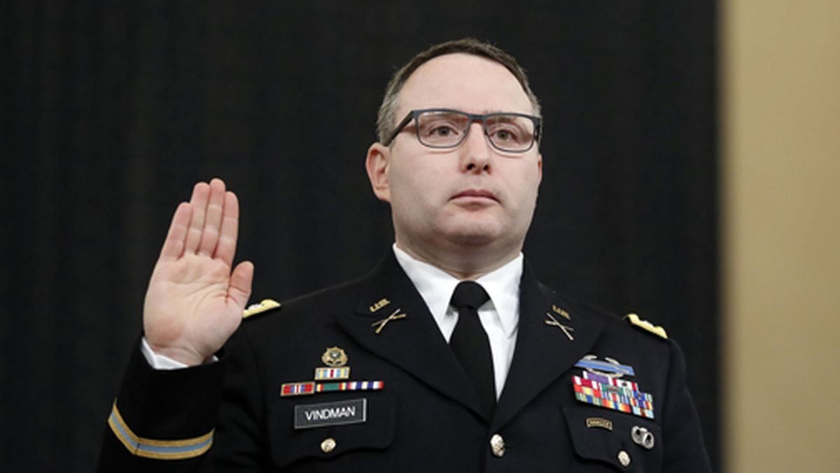 In this Nov. 19, 2019 file photo, National Security Council aide Lt. Col. Alexander Vindman is sworn in to testify before the House Intelligence Committee on Capitol Hill in Washington during a public impeachment hearing of President Donald Trump's efforts to tie U.S. aid for Ukraine to investigations of his political opponents. Vindman was escorted out of the White House complex on Friday, Feb. 7, 2020, according to his lawyer. (AP Photo/Andrew Harnik, File)