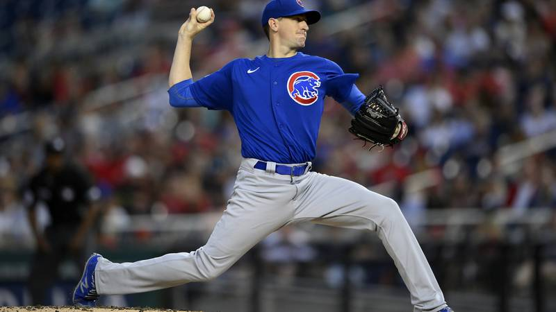 Chicago Cubs starting pitcher Kyle Hendricks delivers during the third inning of a baseball...