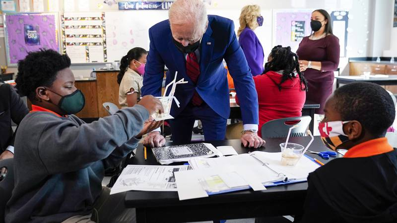 FILE - In this Sept. 10, 2021, file photo President Joe Biden talks to students at Brookland...