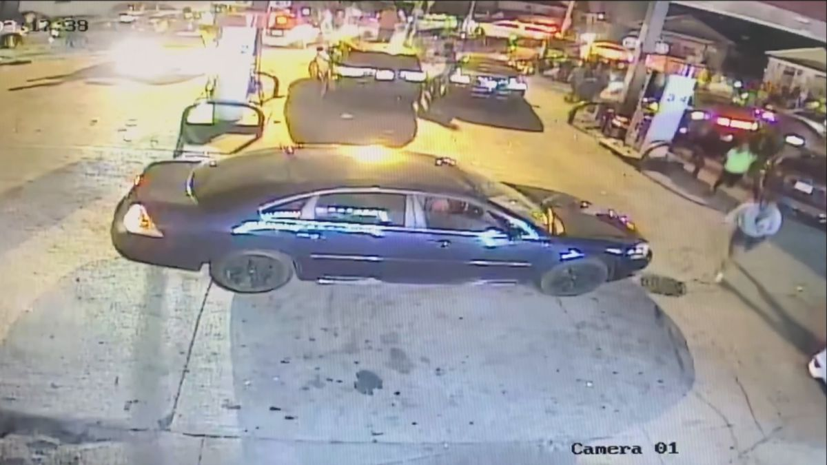 Dozens of people captured on surveillance images dispersing in a panic moments after shots rang out outside a local gas station near Bertrand Street & North Olive Street early Sunday morning.