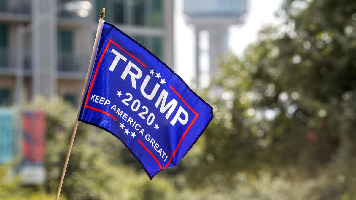 A Trump 2020 flag flies in front of Reunion Tower before a campaign rally for President Donald Trump, Thursday, Oct. 17, 2019, at the American Airlines Center in Dallas. (AP Photo/Jeffrey McWhorter)