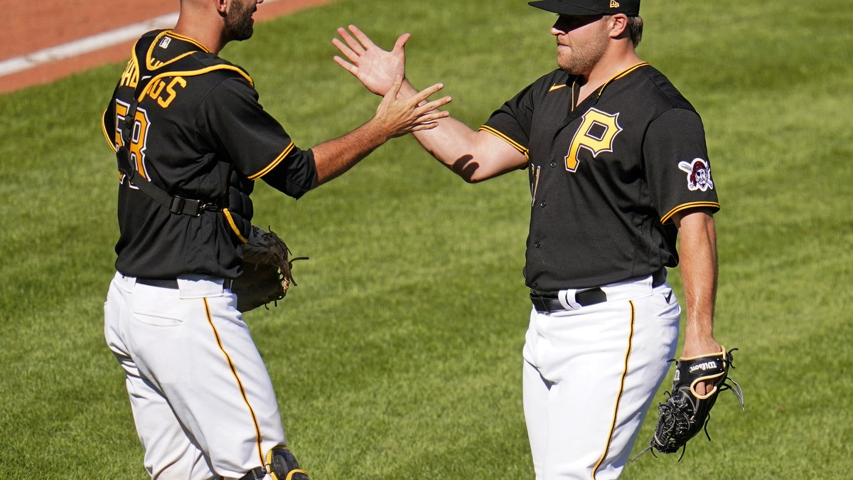 Pittsburgh Pirates relief pitcher David Bednar, right, celebrates with catcher Jacob Stallings...