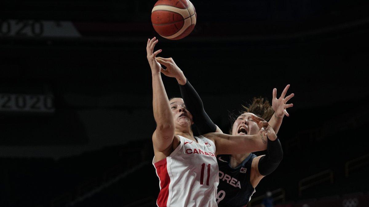 Canada's Natalie Achonwa (11), left, and South Korea's Ji Su Park (19) scramble for a rebound...
