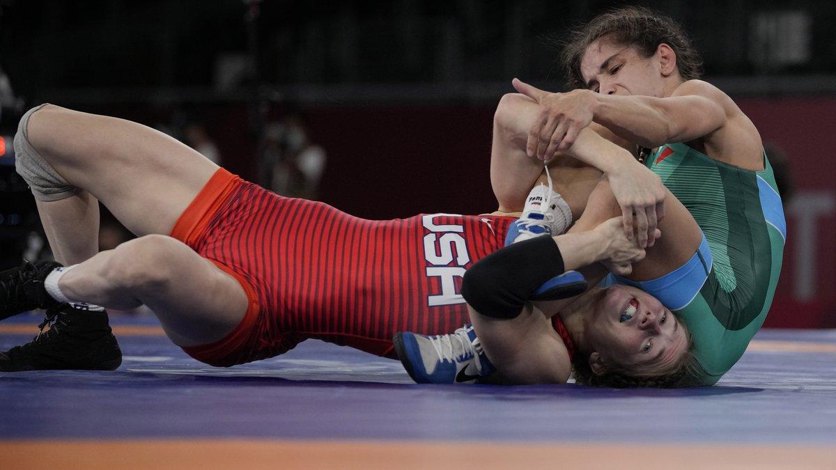 United States' Saran Ann Hildebrandt, bottom, competes against Bulgaria's Miglena Georgieva...