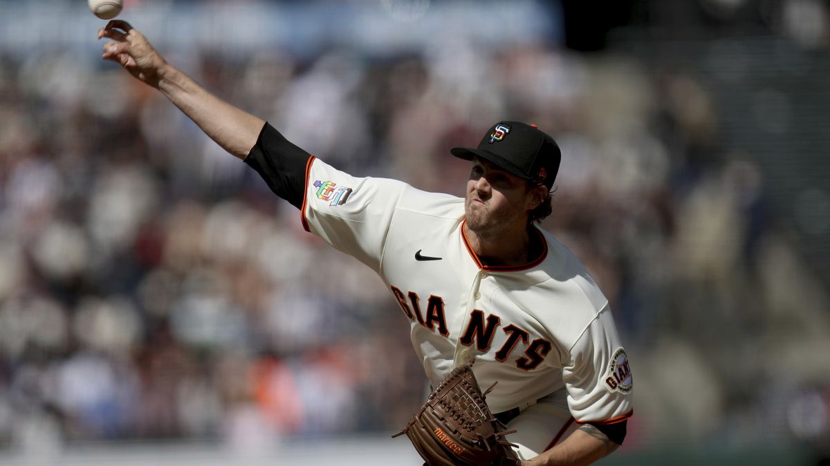 San Francisco Giants starting pitcher Kevin Gausman throws during the first inning of the...