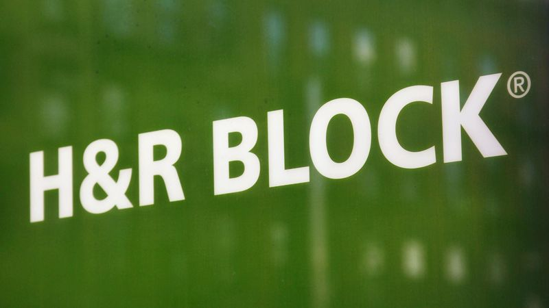 FILE - This March 5, 2012 file photo shows a sign for H&R Block at an office in New York.