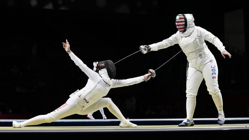 Song Sera of South Korea, left, and Courtney Hurley of the United States compete in the Women's...