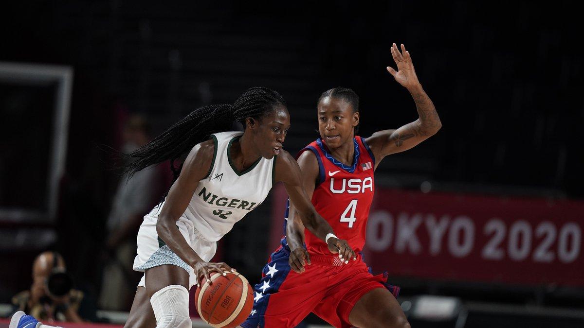 Nigeria's Ify Ibekwe (52) drives past United States' Jewell Loyd (4) during women's basketball...