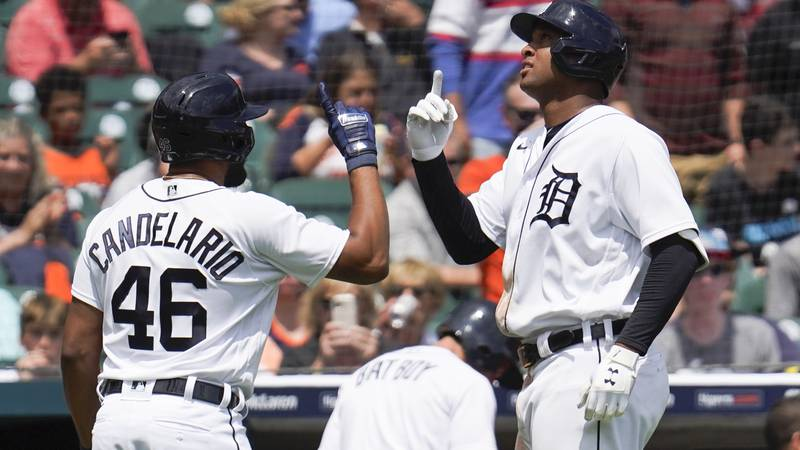 Detroit Tigers' Jonathan Schoop, right, celebrates his solo home run with Jeimer Candelario...