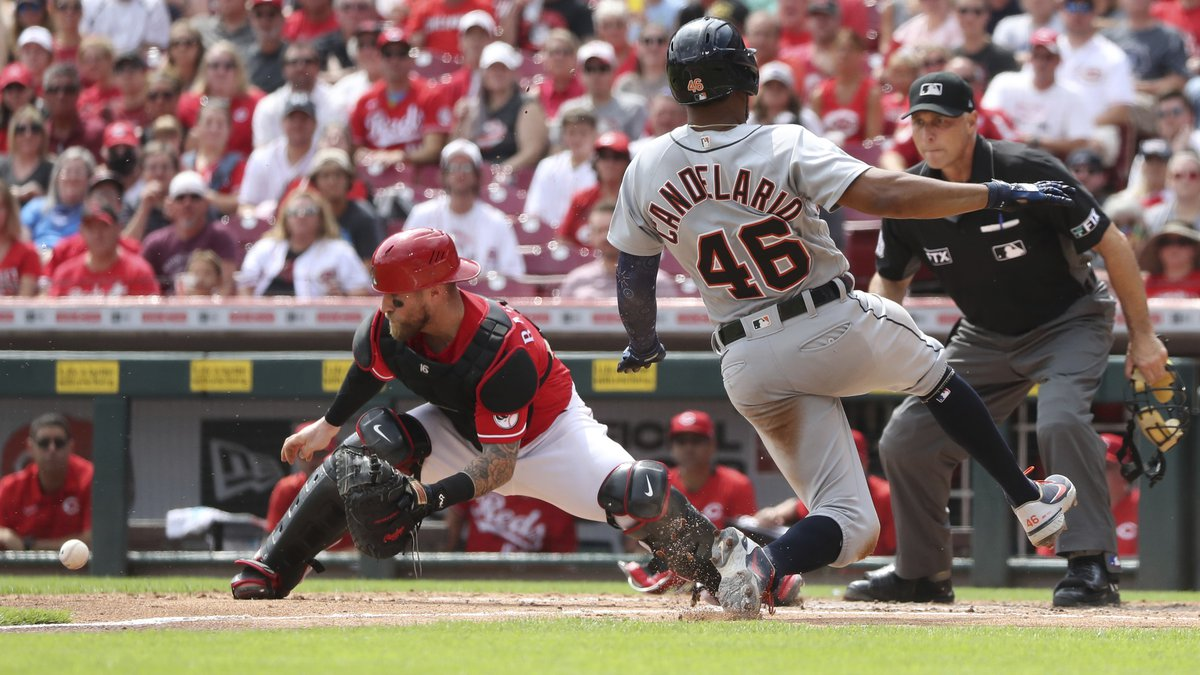 Detroit Tigers' baserunner Jeimer Candelario (46) scores on a sacrifice fly off the bat of Eric...
