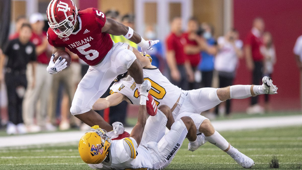 Indiana running back Stephen Carr (5) is hit by Idaho linebacker Coleman Johnson (10) and...