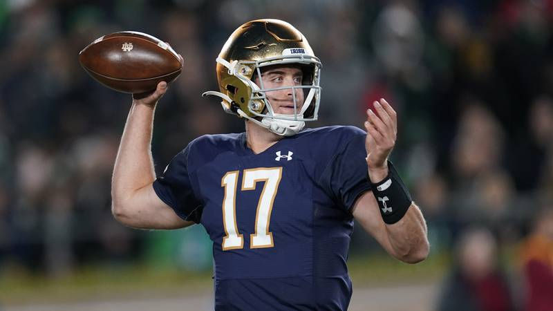 Notre Dame quarterback Jack Coan (17) throws against Southern California in the first half of...