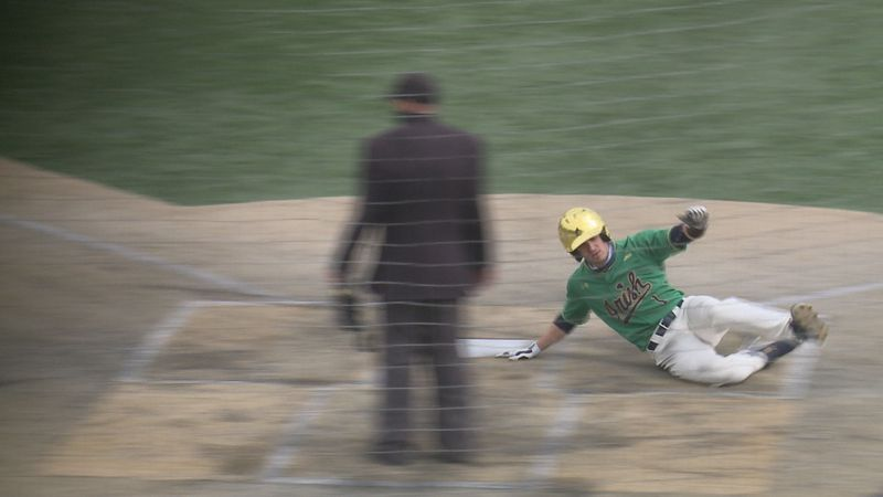 Ryan Cole slides home in 7-0 victory over Georgia Tech.