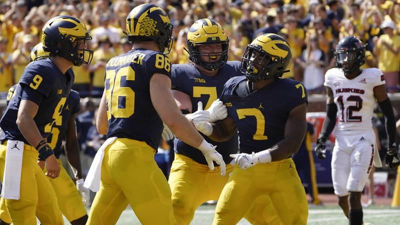 Michigan running back Donovan Edwards (7) celebrates his four-yard touchdown run against...