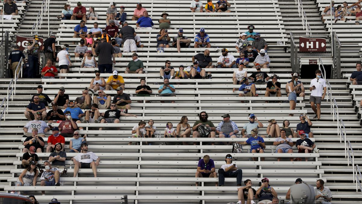 Fans wait for the start of a NASCAR All-Star Open auto race at Bristol Motor Speedway in Bristol, Tenn, Wednesday, July 15, 2020.
