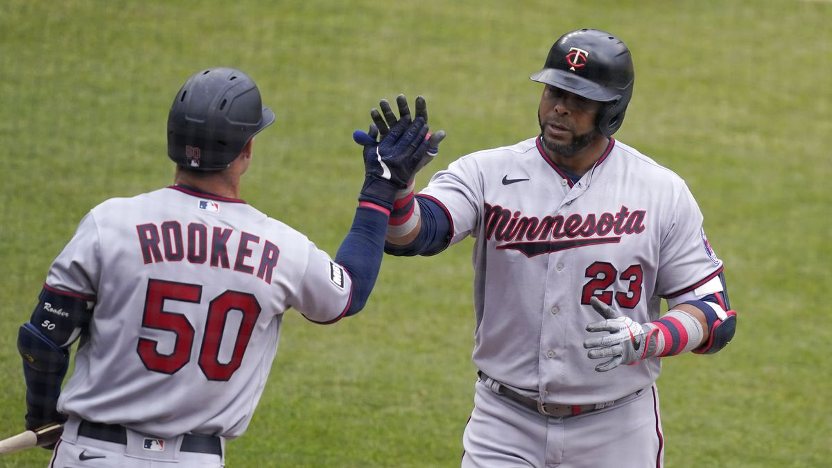 Minnesota Twins designated hitter Nelson Cruz (23) is greeted by teammate Max Kepler after...