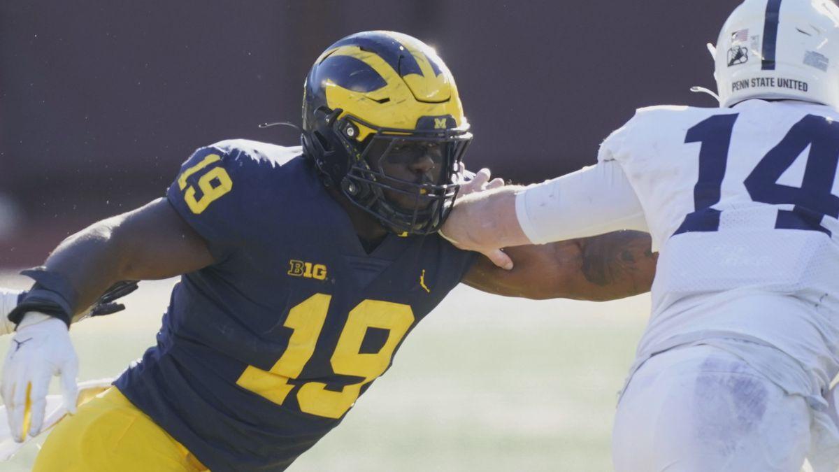 FILE - In this Saturday, Nov. 28, 2020 file photo, Michigan defensive lineman Kwity Paye (19)...