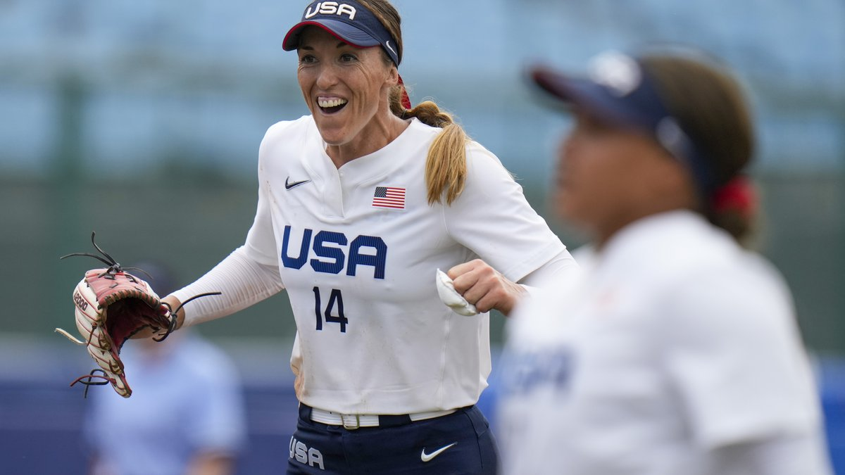 United States' Monica Abbott celebrates after defeating Canada in their softball game at the...
